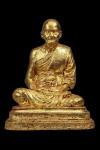 พระบูชารูปเหมือนหลวงปู่ดู่ เนื้อผงพุทธคุณผสมปูนแปะทอง ปี 2525