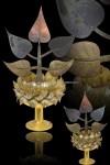 ต้นโพธิ์ 5 ใบ ต้นเล็กทำจากเนื้อทองคำ เนื้อนาค และเนื้อเงิน จัดสร้างเพื่อถวายพระพุทโธคลัง ปี 2540